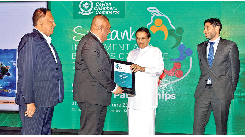 President  Maithripala Sirisena who received the award for the overall winner (Sri  Lanka) of 'Island Economies of the Future 2017/2018' adjudged by the fDi  Magazine, from its Deputy Editor Jacopo Dettoni presenting it back to Finance Minister Mangala Samaraweera. Special Assignments Minister  Dr. Sarath Amunugama looks on. Picture by Vipula Amarasinghe