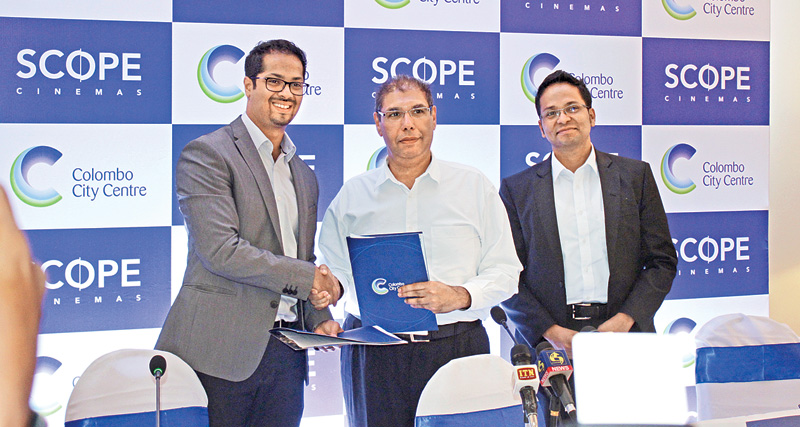 Rusi Pestonjee, Abans Group Director, Naveed Cader, Chairman, Scope Cinema (Pvt) Ltd and Thushan Rangana at the exchanging of the MoU. Picture by Saliya Rupasinghe