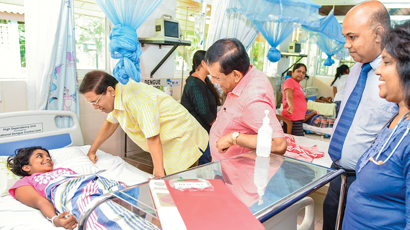 President Maithripala Sirisena inquiring into the well-being of a patient during the visit.