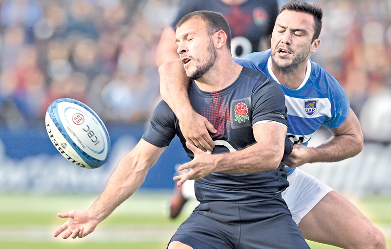 England's scrum half Danny Care (left) is tackled by Argentina's Los Pumas scrum half Martin Landajo during their rugby union Test match at Lopez Stadium on Saturday. AFP