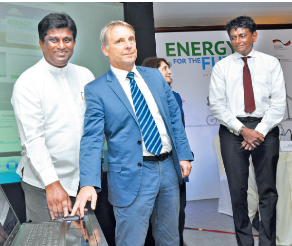Ajith C Perera Deputy Minister of Power and Renewable Energy and German Ambassador to Sri Lanka and the Maldives Jorn Rohde  re-launching the Green Energy 2017 Champion official website in Colombo.  Picture by Thushara Fernando