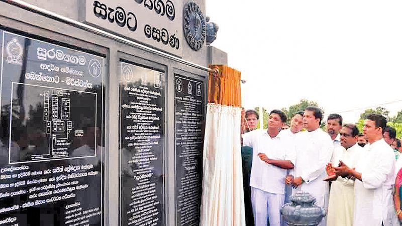 Housing and Construction Minister Sajith Premadasa  unveiling the plaque to mark the inauguration of 'Suramayagama.' Picture by Mahinda  P. Liyanage. Galle Central Special Corr.