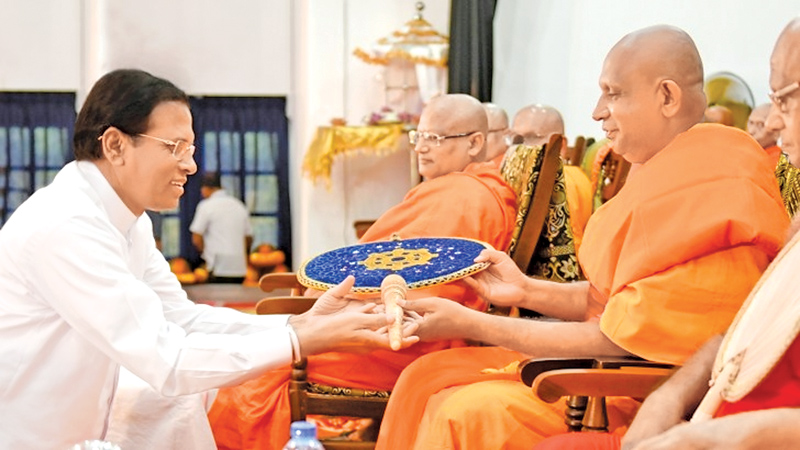 President Maithripala Sirisena presenting the Scroll to the newly elected Chief Sanganayaka of the Eastern Province and Thamankaduwa, Egodapattu, Venerable Makuruppe Pannasekara Nayaka Thera