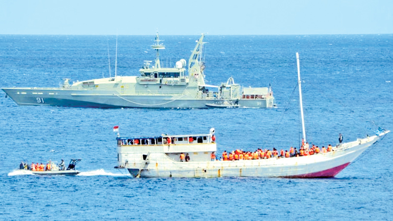 The Australian Navy intercepts a boat carrying asylum seekers.