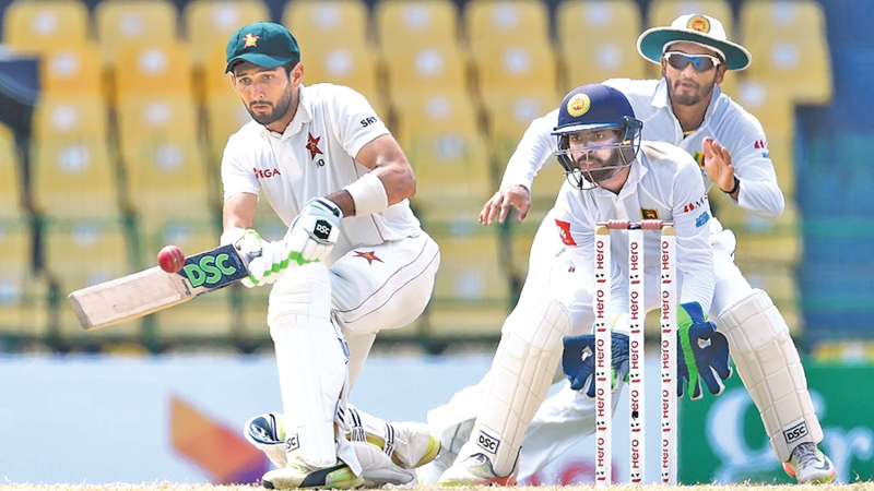 Sikander Raza the savior of Zimbabwe with an unbeaten 97 brings out the sweep shot that has been quite productive during the third day of the one-off Test against Sri Lanka at the R Premadasa Stadium yesterday. AFP