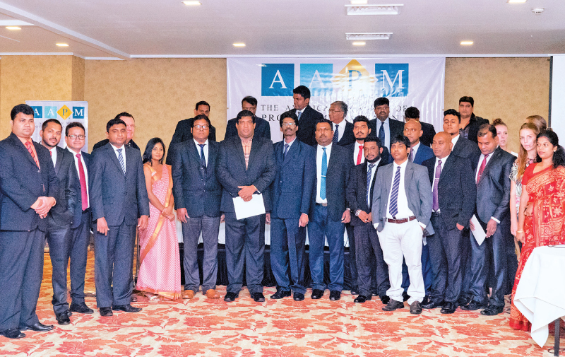 Foreign Affairs Minister Ravi Karunanayake received the Master Project Manager certification from Colorado, USA-based The American Academy of Project Management (AAPM) honouring his continuous efforts for economic and trade reforms, at a function recently held at Hilton Colombo. Here the Minister with Country Representative Rajkumar Kanagasingam and some of the local and overseas participants. AAPM is the first graduate certification body to earn accreditation from the TUV-OE in Europe as ISO Certified 9001