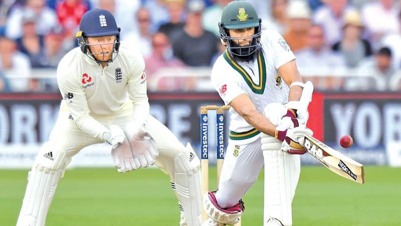 South Africa's Hashim Amla (R) plays a shot as England's Jonny Bairstow keeps wicket during play on the third day of the second Test match between England and South Africa at Trent Bridge cricket ground in Nottingham, central England on July 16. AFP