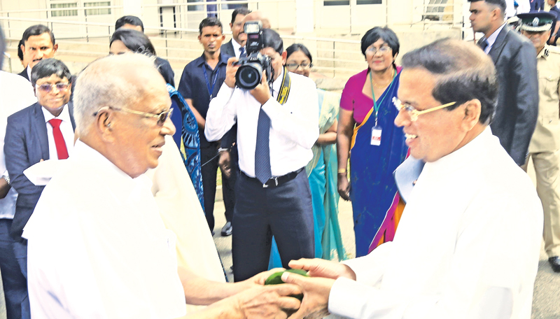 Dr. Neville Fernando welcoming President Maithripala Sirisena on his arrival to attend the agreement signing ceremony to transfer the ownership of the Neville Fernando Teaching Hospital to the government held on  Monday.  Picture by Nirosh Batepola