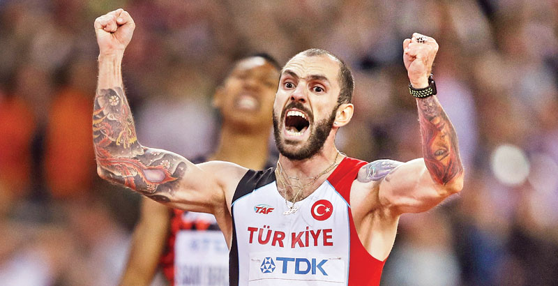 Turkey's Ramil Guliyev reacts as he wins the final of the men's 200m athletics event at the 2017 IAAF World Championships at the London Stadium in London on August 10. AFP