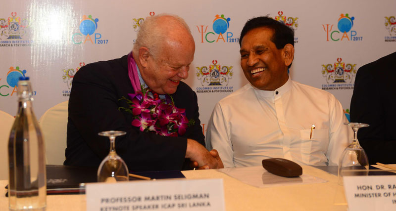 Health Minister Dr. Rajitha Senaratne in conversation with Prof. Martin Seligman during the conference.