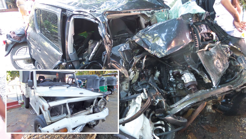The car and the double cab that collided at Batugedara junction in Ratnapura yesterday.