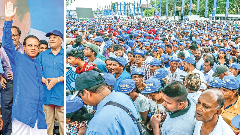 Sri Lanka Freedom Party (SLFP) Chairman and President Maithripala Sirisena waving to thousands of enthusiastic and fervent party supporters who participated in the SLFP's 66th Anniversary Convention at Campbell Park, Borella yesterday.Pictures by Sudath Silva.