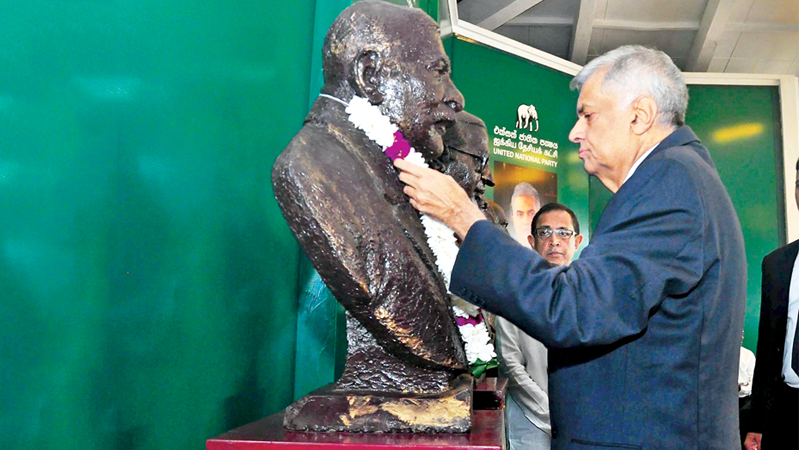 "Prime Minister Ranil Wickremesinghe participating at the 71st anniversary celebrations of the UNP held at the ""Siri Kotha' party headquarters yesterday. The proceedings began with the garlanding of the statues of former UNP leaders."