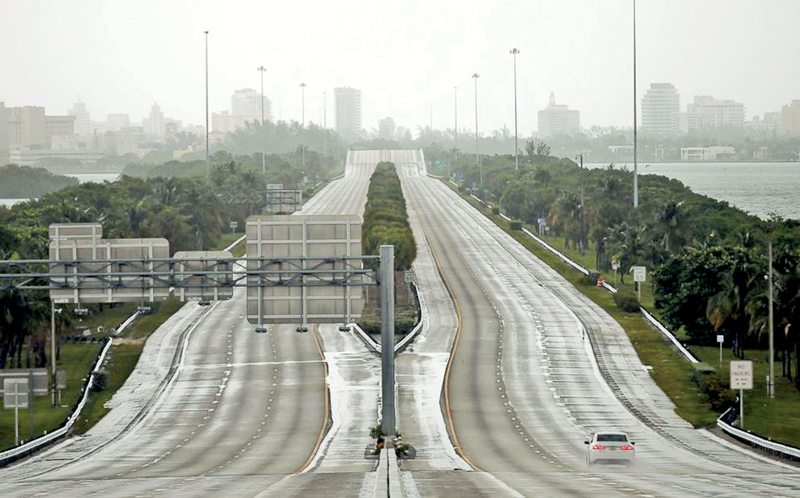 A car drives along an empty highway in Miami before the arrival of Hurricane Irma