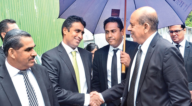 Perpetual Treasuries beneficiary owner Arjun Aloysius in conversation with his attorneys Gamini Marapana PC,G.G.Arul Pragasam and Navin Marapana outside the Commission office yesterday. Picture by Wimal Karunathilake.