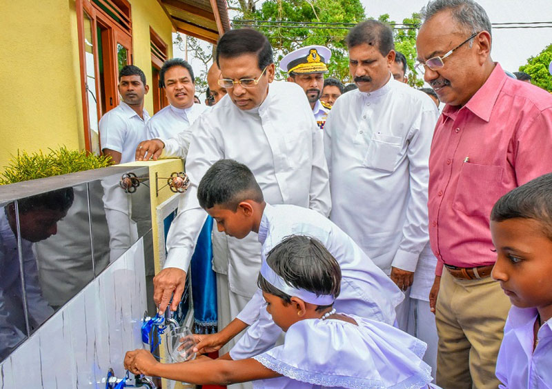 President Maithripala Sirisena inaugurating a drinking water project in Horowpothana last week. Picture by Sudath Silva.