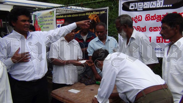 Postcard campaign in support of Buddhist monks at Ginigathhena