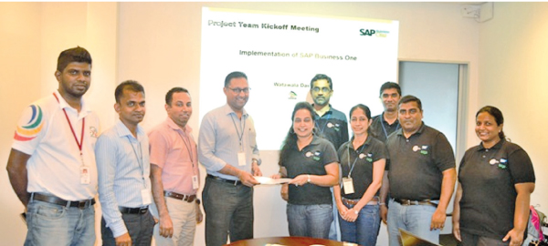 Cap PBSS officials exchanging the agreement with Watawala Dairy officials for SAP  Business One ERP implementation