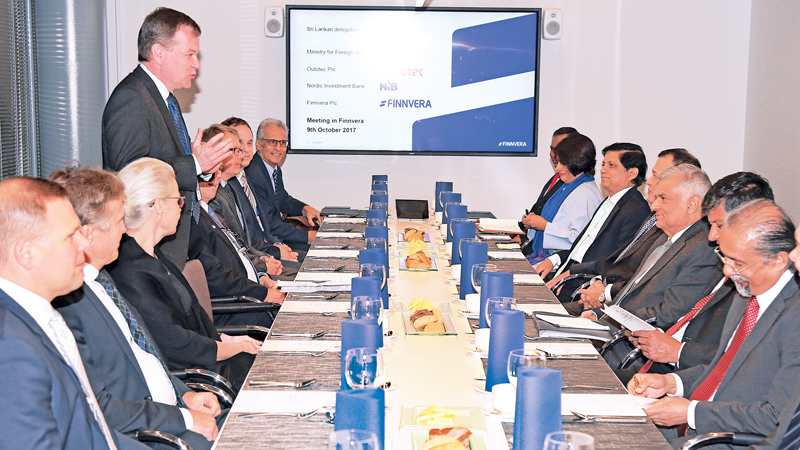 Prime Minister Ranil Wickremesinghe who is on an official visit to Finland met with officials from the Finnvera, Nordic Investment Bank and Outotec organizations