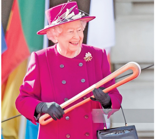 The Queen's Baton Relay launched by Queen Elizabeth II of Great Britain on March 13 from Buckingham Palace in London as a run-up to the Commonwealth Games 2018, which will be held in Australia. Here Queen Elizabeth II holding the Gold Coast Queen's Baton. (Picture courtesy BBC)