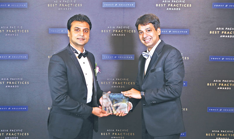 Thivanka Rangala, CFO, edotco Group receiving the 2017 Asia Pacific Telecoms Tower Company of the Year Award by Frost & Sullivan in Singapore.