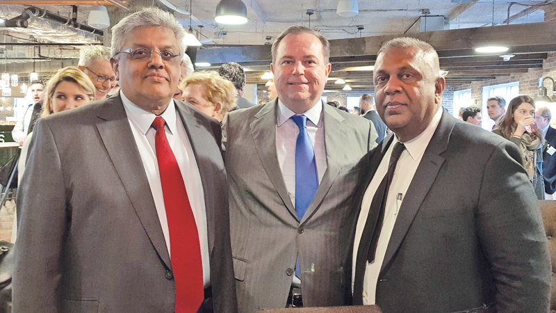 Picture shows Minister Mangala Samaraweera with Newsmax CEO Christopher Ruddy and Senior Advisor to the Minister of Finance Mano Tittawella.