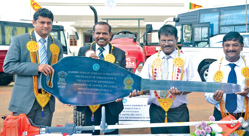 Consul General of India in Jaffna A.Natarajan and D.C. Manjunath, Head of Development Cooperation Wing, High commission of India in Colombo making a token presentation of the material to the Vice Chancellor of the University R.Vigneswaran at a ceremony held on Monday at the Killinochchi Campus.