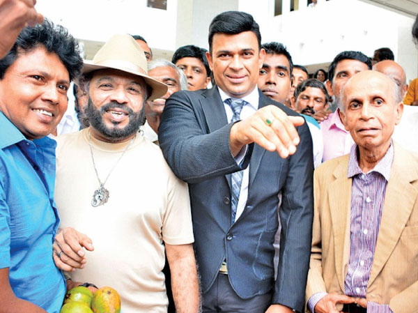 Deputy Minister Ranjan Ramanayake with Prof.Carlo Fonseka and Singer Sunil Perera outside the Supreme Court yesterday. Picture by Ranjith Asanka.