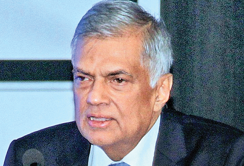 Prime Minister Ranil Wickremesinghe addressing the SLEA forum yesterday.Pictures by Saliya Rupasinghe.