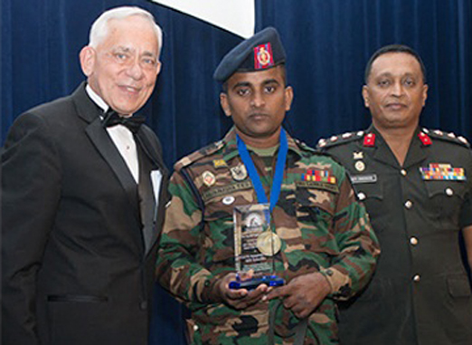 Sri Lanka Army Engineers Brigade Commander,Brigadier Amith Seneviratne with MDD 'Yankee' and Lance Corporal Rajapakshain Washington after receiving the award from MLI's President and Executive Director Perry F. Baltimore.