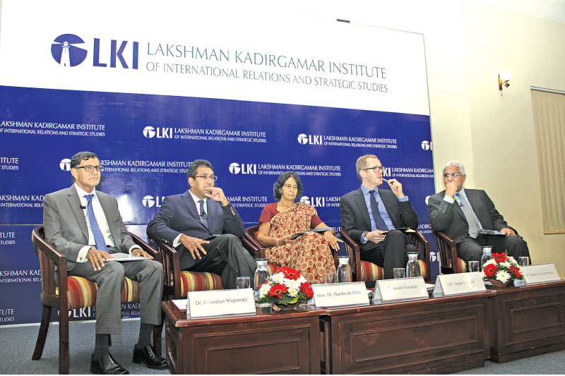 Dr Ganeshan Wignaraja, Deputy Minister Dr Harsha De Silva, Sarala Fernando, James Crabtree and Central Bank Governor Dr. Indrajit Coomaraswamy, at the Lakshman Kadirgamar Institute, yesterday.  Picture by Saliya Rupasinghe