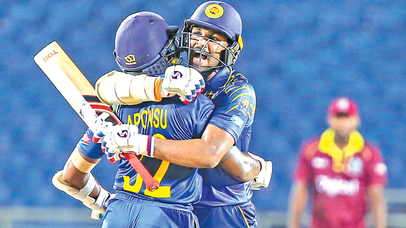 Man of the Match Amila Aponso embraces Shehan Jayasuriya after the two had guided Sri Lanka A to victory in the first unofficial ODI played at Sabina Park, Jamaica on Wednesday.