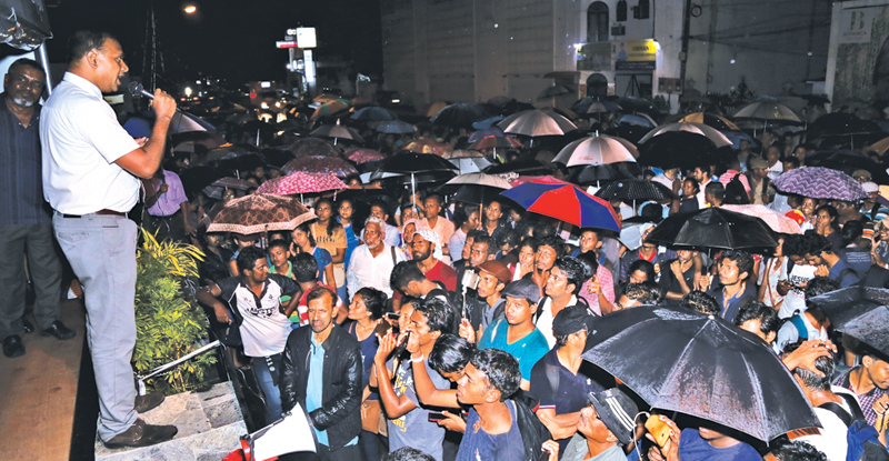 The fast unto death launched by Medical Faculty Students' Parents Association near the University Grants Commission (UGC) premises at Ward place, Colombo 7, was called off yesterday evening, following a discussion with Deputy Minister Harsha de Silva. Here, a member of the MFSPA announcing the decision to end the protest to a crowd gathered in front of the stage where the protest was held. Picture by Rukmal Gamage