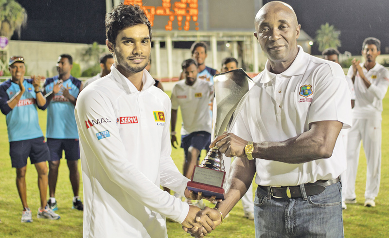 Captain Dhananjaya de Silva, receives the unofficial test series trophy after Sri Lanka won the series 2-1.