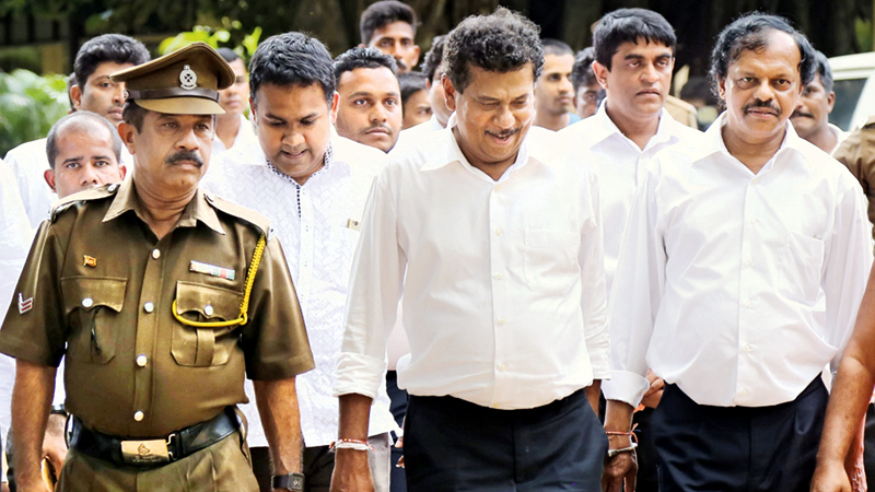 Former President's Chief of Staff, Gamini Sedara Senarath and the other two suspects, former Sri Lanka Insurance Corporation Managing Director Piyadasa  Kudabalage and former Samurdhi Commissioner Neil Bandara Hapuwinna being taken to prison.Picture by Rukmal Gamage