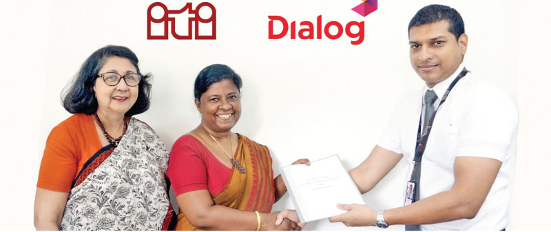 IDRC and ITI Project Manager,  Dr. Shanthi Wilson  Dr. Ilmi Hewajulige, Senior Deputy Director - Industrial Technology Institute (ITI) and Charitha Ratwatte, Head of Group Sustainability Dialog Axiata Group exchanging the agreement.
