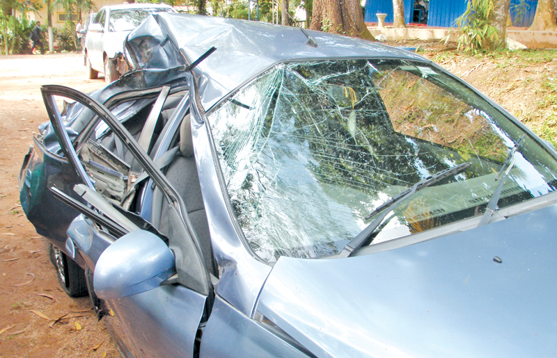 The badly damaged car that collided with a train at the Heendeniya-Pattiyagoda Railway Crossing yesterday.