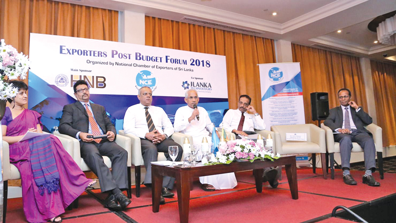 State Minister Eran Wickramaratne, Principal Tax and Regulatory, and Director of Secretarial Services of KPMG, Suresh Perera and other officials at the NCE post-budget seminar