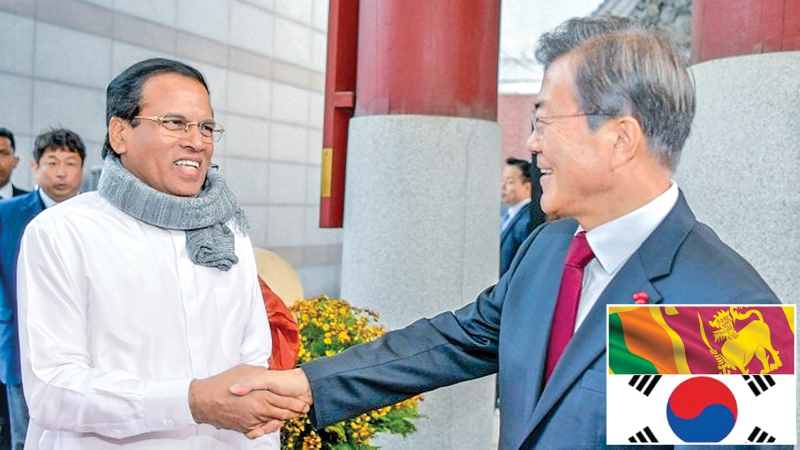 Warm welcome for President : President Maithripala Sirisena received a warm welcome when he arrived at the Incheon International Airport in Seoul last morning (November 28) for a three day state visit to the Republic of Korea on an invitation extended by the Korean President Moon Jae-in. President Sirisena, who visited the famous Jogyesa Temple, was surprised to find President Moon waiting to receive him, unannounced. Picture by Sudath Silva.