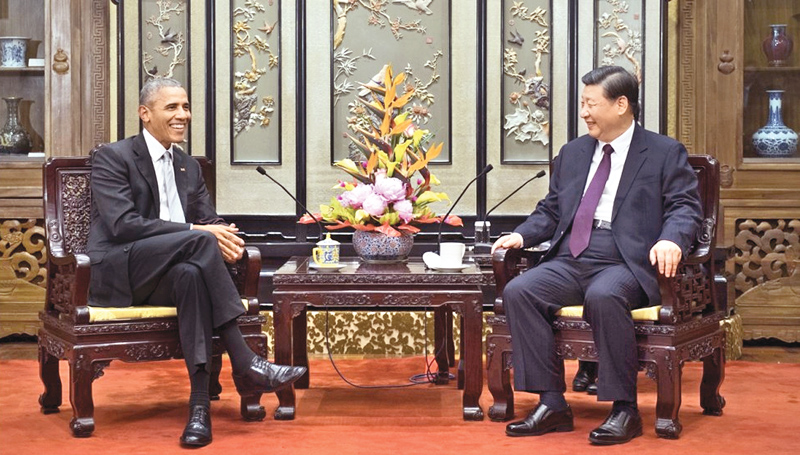 Chinese President Xi Jinping meets former US President Barack Obama in Beijing on Wednesday. - XINHUA