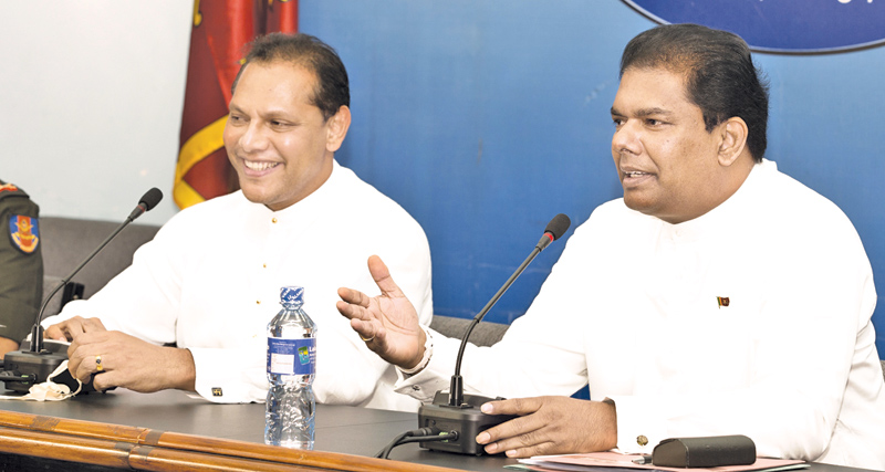 Cabinet Co-Spokesmen Gayantha Karunathilleke and Sports Minister Dayasiri Jayasekera speaking at the Cabinet briefing held at the Government Information Department premises yesterday. Picture by Gamini Ramanayake