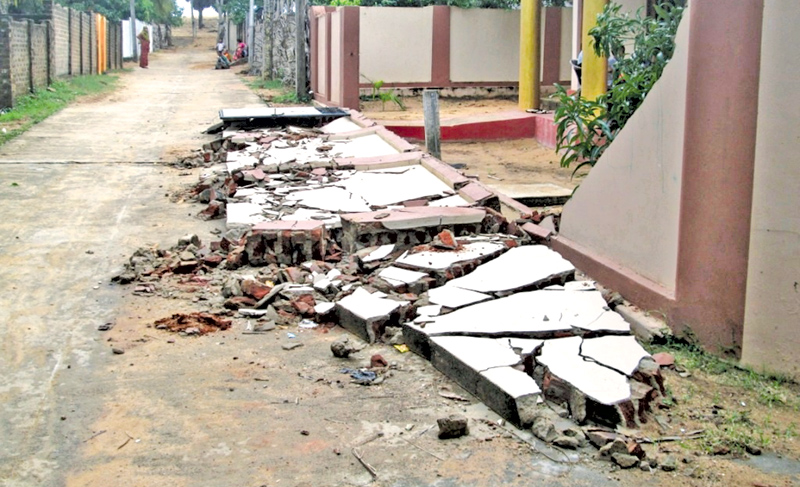 A parapet wall destroyed by an elephant. Picture by I. L. M. RIZAN, Addalaichenai Central Corr.