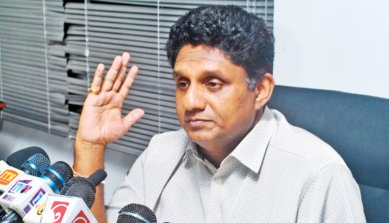 Housing and Construction Minister Sajith Premadasa addressing yesterday's press conference. Picture by Siripala Halwala