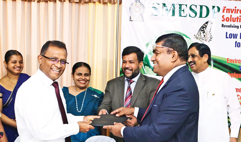 Minister Rishad Bathiudeen with Ministry Secretary KDN Ashoka and State Minister Champika Premdasa witnesses green loan agreement by the Ministry with one of the credit institutions (BoC-reps) in Colombo.