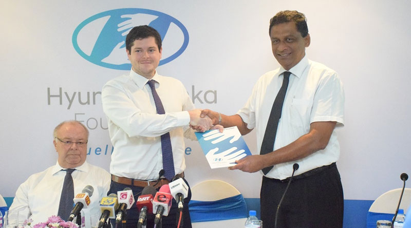 Julian Reuter, Director of Hyundai Lanka (Pvt) Ltd exchanging the MoU with KeerthiHettiarachchi, Senior Project Director Programmes- SOS Children's Villages Sri Lanka.  Picture by Saliya Rupasinghe