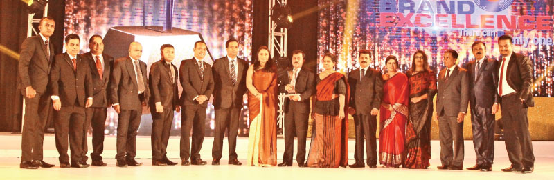 People's Bank officials with the award.