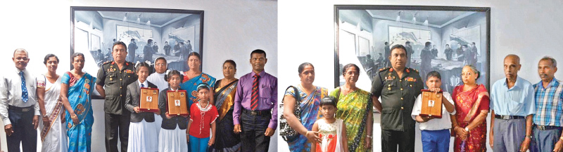 Jaffna Security Forces Commander, Major General Darshana Hettiarachchi gifted school bags, stationeries and books and mementos to the students in appreciation of their outstanding achievements.Principals and teachers of respective schools along with parents of students look on.