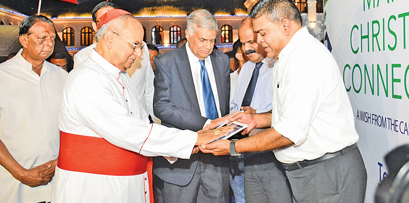 "His Eminence Malcolm Cardinal Ranjith, the Archbishop of Colombo and Prime Minister Ranil Wickremesinghe inaugurating ""The Christmas Fest 2017"" at the Arcade - Independence Square in Colombo last evening. The event is organised by the Ministry of Tourism and Christian Religious Affairs and the Sri Lanka Tourism Promotion Bureau.The festival will be held from December 20 - 22nd from 6.00 p.m. to 12.00 midnight. Minister John Amaratunga and Sri Lanka Telecom Chairman Kumarasinghe Sirisena are in the picture."
