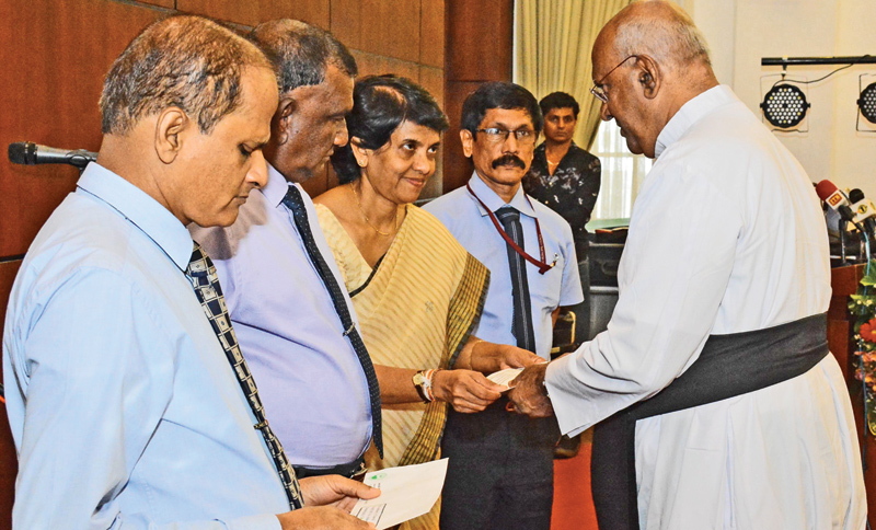 A donation was made by Colombo Municipal Council Commissioner V.K.Anura and other CMC officials to a Parish Priest of one of the churches. Picture by Sarath Peiris