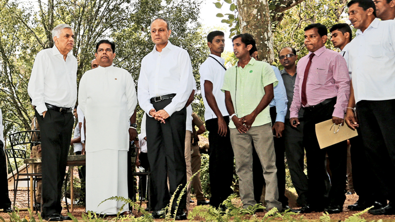 Prime Minister Ranil Wickremesinghe with Ministers Sagala Ratnayake and Gayantha Karunathilaka, at the site.